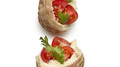 2 mini hummus and tomato sandwiches