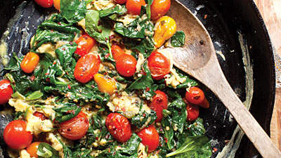 Blistered tomato and spinach scramble