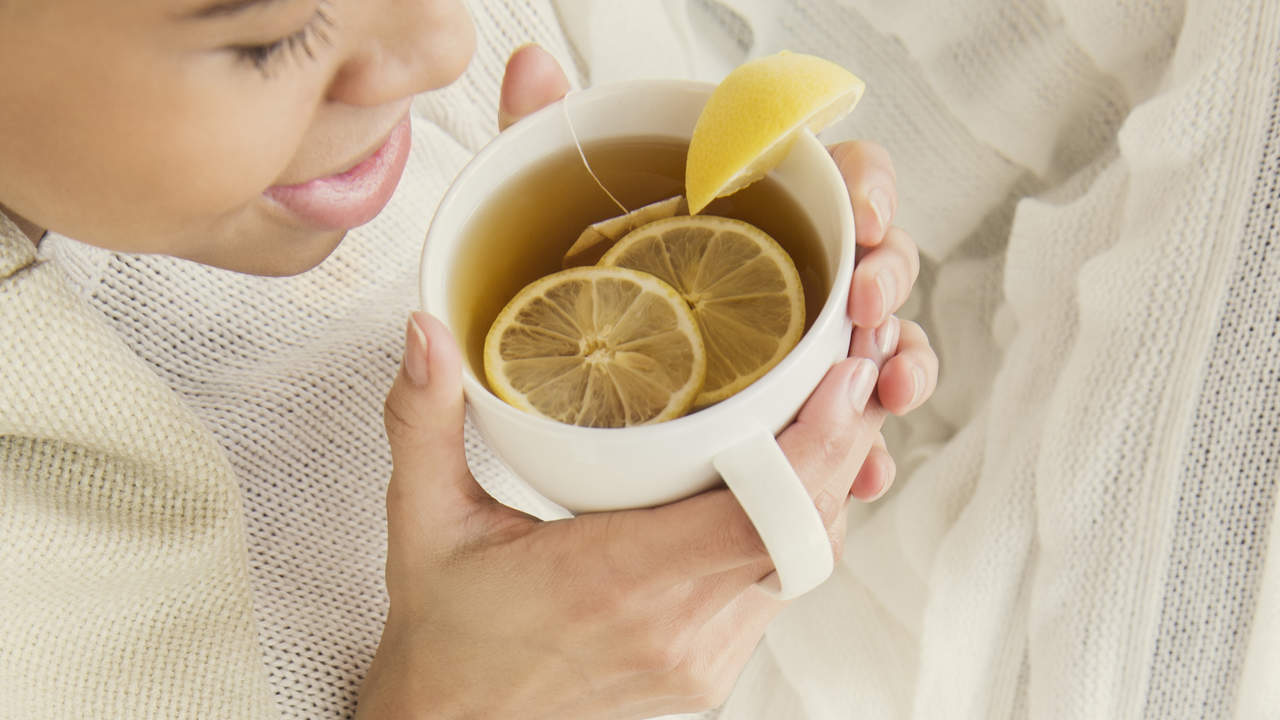 Woman drinking herbal tea with fruit