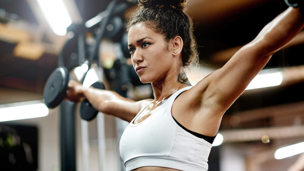 Woman lifting weights in the gym