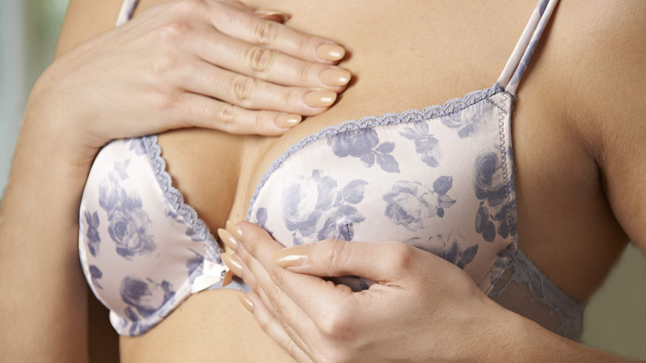 woman feeling breast for lump self exam