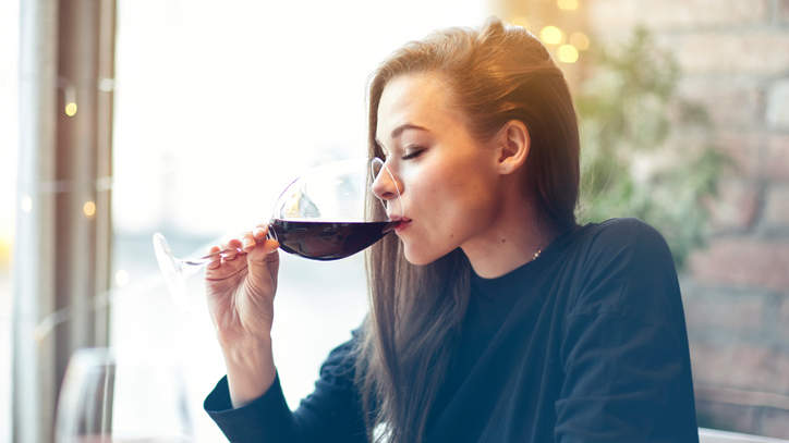 Woman drinking red wine alcohol health effects brain