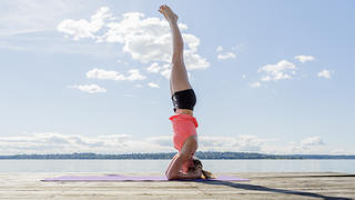tax-headstand-yoga-beach