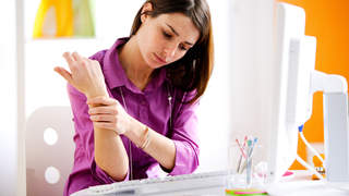 psoriatic-arthritis-wrist-pain-office