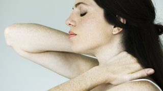 psoriatic-arthritis-holding-back-neck-pain