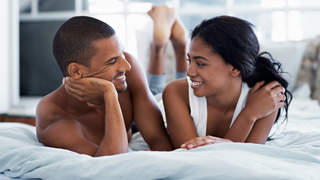 couple-talking-bed-sleep-better