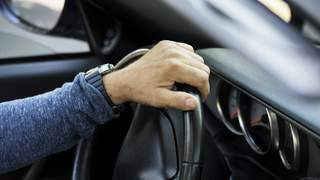 Closeup of hand on steering wheel