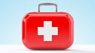 First aid kit standing on a blue and white background TIME health stock