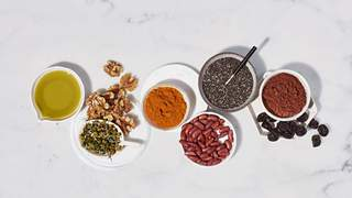 wellness-pantry-health-mag-september-2019 wellness food diet pantry chia-seeds nuts chamomile beans cocoa turmeric olive-oil