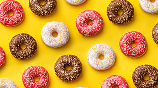 Flat lay donuts pattern on a yellow background