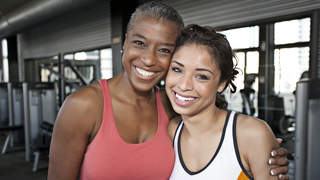 mother-daughter-gym-smile-workout