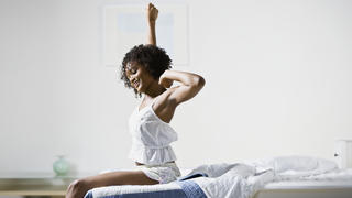 sleep-benefits-waking-up-bed-stretch