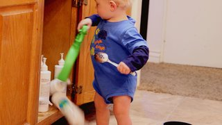 child-kitchen-cleaning-supplies-danger